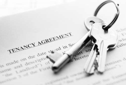keys-on-top-of-tenancy-agreement-document